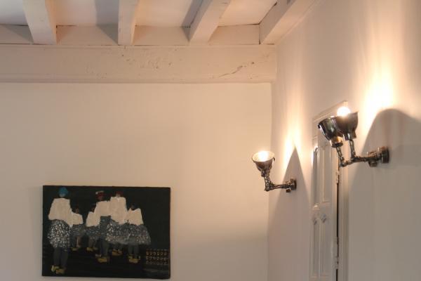 Stupenda doppia lampada da parete che illumina molto bene la stanza ed è anche molto pratica perché permette di direzionare la luce!