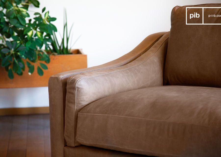 Offrendo un comfort incomparabile grazie ai suoi cuscini di seduta generosamente imbottiti sopra le