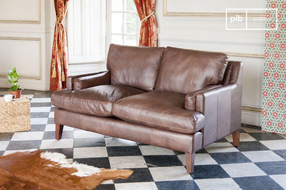 Realizzato in pelle pieno fiore, un divano a due posti senza tempo
