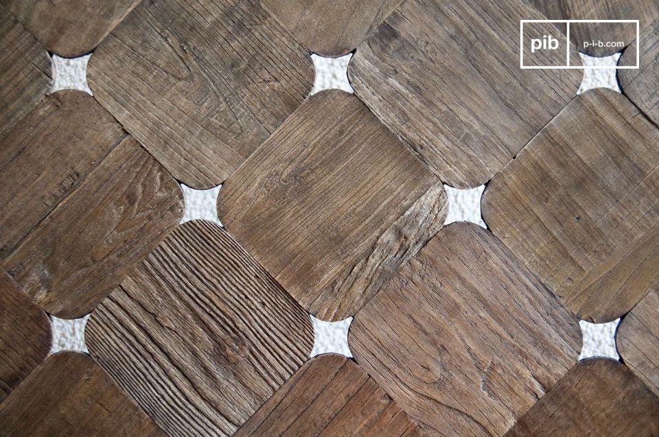 Fatto di quadrati di legno con bordi arrotondati che lasciano passare sottilmente passare la luce