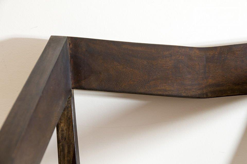 La sobrietà di queste sedie moderne con i suoi braccioli
