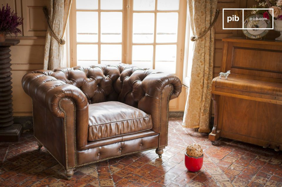 Aggiungi un tocco tipico dei club inglesi al tuo salotto con le sedie design e un divano